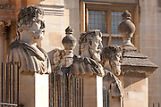 "Emperors Heads, Sheldonian theatre, Broad St, Oxford. The official name for such heads is ""herms""; the original accounts describe these heads as ""termains""; and some people call them philosophers. But Max Beerbohm in Zuleika Dobson called them ""Emperors"", and that is the name that has stuck. Each head shows a different type of beard. The present heads are the third set carved between 1970 and 1972 by Michael Black. The first set lasted 200 years, but by 1868 they were crumbling and new ones were erected; undergraduates, however, daubed these in paint, and the harsh cleaning they received caused them to wear badly, so that they could be described by John Betjeman (in his verse autobiography Summoned by Bells) as ""the mouldering busts round the Sheldonian"" when he came up in 1925."