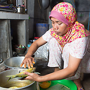 CAPTION: Mukhayanah is making fishcakes to sell locally. She says she would like to sell to a wider range of people in the future. Sadly, she has no way of storing her produce at the moment, so she is only able to service specific orders. LOCATION: Wonosari, Semarang, Indonesia. INDIVIDUAL(S) PHOTOGRAPHED: Mukhayanah Siyam.