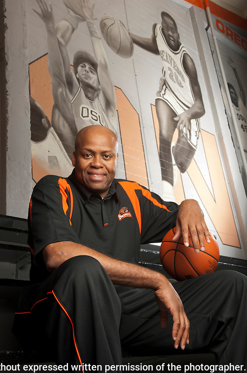 Oregon State University's new head basketball coach Craig Robinson, high in the stands at Gill Coliseum, by a mural portraying past Beaver legends José Ortiz (left) and Gary Payton...©Rich Frishman.ALL RIGHTS RESERVED.This image is not to be published, printed, electronically disseminated or digitally archived without expressed written permission of the photographer...CONTACT INFORMATION:.Rich Frishman.PO Box 1213.Langley, WA 98260  USA..360-221-1984 phone.rich@frishphoto.com e-mail.http://www.frishphoto.com.http://www.richfrishman.com