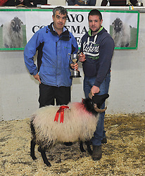 Mayo/Connemara Sheep Show of Blackface Rams. 1st place Ram Lamb went to Padraig Joyce, Cloch Breac collecting his prize from John Noonan.<br />