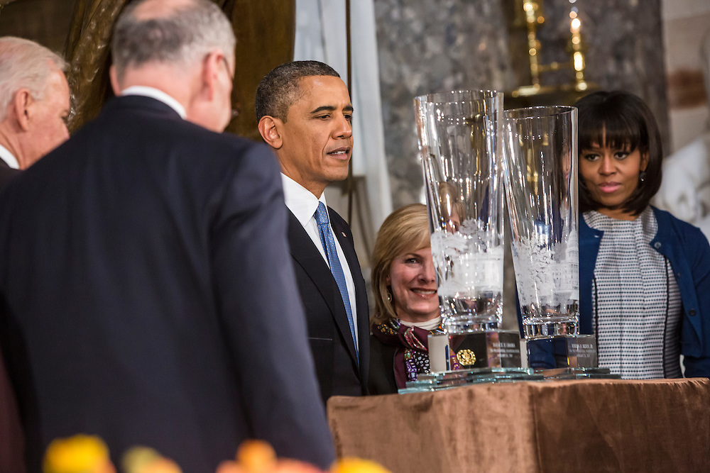 President Barack Obama and First Lady Michelle Obama look at crystal vases presented as gifts to the President and Vice President at the Inaugural Luncheon in Statuary Hall at the U.S. Capitol on Monday, January 21, 2013 in Washington, DC.