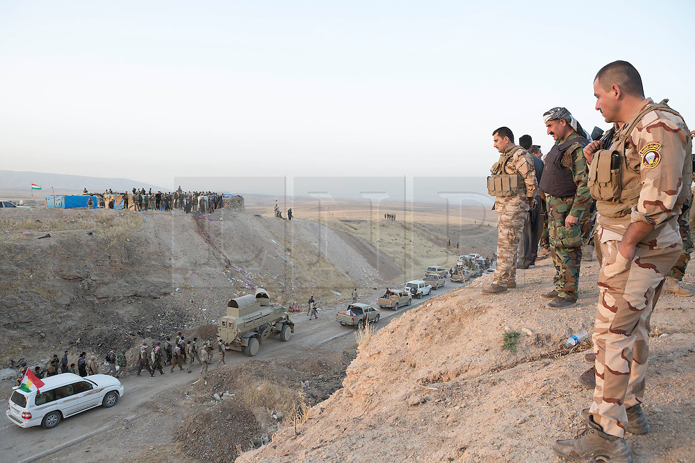20/10/2016. Bashiqa, Iraq. Pickup trucks and armoured vehicles belonging to Iraqi-Kurdish peshmerga fighters queue as they begin to drive into no-mans land as part of an operation to retake Mosul from Islamic State militants today (20/10/2016). <br /> <br /> Launched in the early hours of today with support from coalition special forces and air strikes, the attack is part of the larger operation to retake Mosul from the Islamic State, and involves both the Kurds and the Iraqi Army. The city of Bashiqa, around 9 miles north of Mosul, is one of several gateway areas that must be taken before any attempted offensive on Mosul itself.<br /> <br /> Despite the peshmerga suffering several casualties after militants fought back using mortars, heavy machine guns and snipers, the Kurdish forces were quickly taking ground with Haider al-Abadi, the Iraqi prime minister, stating that the operation to retake Mosul was progressing faster than expected. Photo credit: Matt Cetti-Roberts/LNP