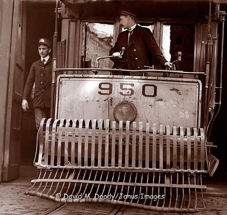 Conductors on a trolley car, possibly San Francisco, California, circa 1900
