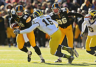 November 23 2013: Iowa Hawkeyes holder Connor Kornbrath (98) tries to get away from Michigan Wolverines linebacker James Ross III (15) as Iowa Hawkeyes kicker Mike Meyer (96) looks on during the second quarter of the NCAA football game between the Michigan Wolverines and the Iowa Hawkeyes at Kinnick Stadium in Iowa City, Iowa on November 23, 2013. Iowa defeated Michigan 24-21.