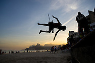 A young boy shows off by somersaulting from the sea wall at Ipanema beach, Rio de Janeiro, Brazil. Picture by Andrew Tobin/Focus Images Ltd +44 7710 761829<br /> 27/06/2014
