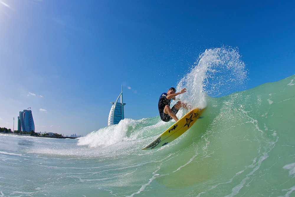 Graeme Fenton surfing in Dubai with the Burj Al Arab in the background