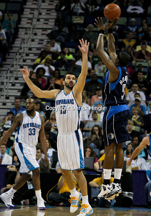 12 April 2009: Dallas Mavericks forward Josh Howard (5) shoots over New Orleans Hornets forward Peja Stojakovic (16) during NBA game between the New Orleans Hornets and the Dallas Mavericks on Easter Sunday at the New Orleans Arena in New Orleans, Louisiana.