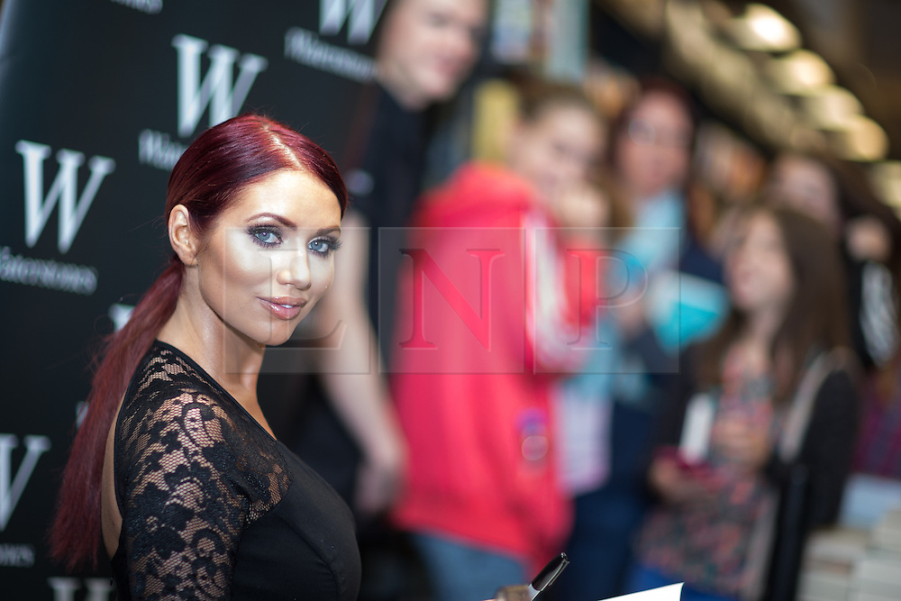 © Licensed to London News Pictures . 10/10/2015 . Manchester , UK . People queue as AMY CHILDS signs copies of her book , 100% Me , at Waterstones in the Trafford Centre in Manchester . Photo credit : Joel Goodman/LNP