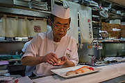 On one of the sushi restaurants in Tsukiji market, a chef prepares a meal of sushi. It's hard to get fresher fish...