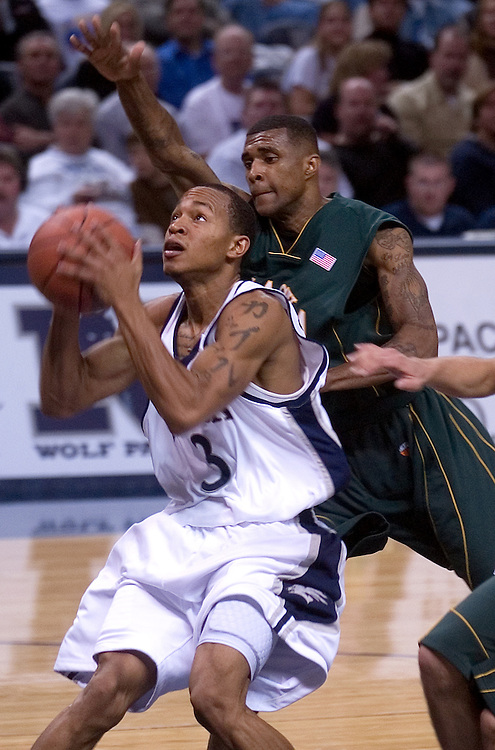 Nevada's Kyle Shiloh (cq) drives past a defender against the Alaska-Anchorage Seawolves, Friday night, Nov. 10, 2006 during the Wolf Pack's (#24/25) 2006 season opener at Lawlor Events Center in Reno, Nev...Photo by David Calvert<br />