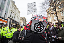 © Licensed to London News Pictures . 28/02/2015 . Newcastle , UK . A man with a swastika marked on a bike helmet at the Pegida demo . Hundreds attend the first Pegida demonstration in the UK , at the Bigg Market in Newcastle . Photo credit : Joel Goodman/LNP