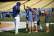 LOS ANGELES, CA - JULY 29:  Yasiel Puig #66 of the Los Angeles Dodgers talks to youngsters during batting practice before the game against the Atlanta Braves at Dodger Stadium on Tuesday, July 29, 2014 in Los Angeles, California. The Dodgers won the game 8-4. (Photo by Paul Spinelli/MLB Photos via Getty Images) *** Local Caption *** Yasiel Puig