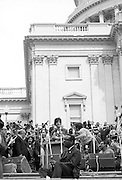 On April 22, 1971, Vietnam veteran Lt. John Kerry became the first Vietnam veteran to testify before Congress about the war, when he appeared before a Senate committee hearing on proposals relating to ending the war.<br /> Kerry is shown here at the speaker's podium on the U.S. Capitol steps the day after his testimony - April 23, 1971 - as he participated in a demonstration with thousands of other veterans in which he and other veterans threw their medals and ribbons over a fence erected at the front steps of the United States Capitol building to dramatize their opposition to the war. - To license this image, click on the shopping cart below -
