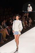 White and blue short shorts with oversized, outside pockts,  and a long-sleeved white blouse with Peter Pan collar.