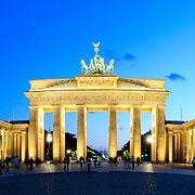The Brandenburg Gate (German: Brandenburger Tor) is a former city gate and one of the main symbols of Berlin and Germany. It is located west of the city centre at the junction of Unter den Linden and Ebertstraße, immediately west of the Pariser Platz. It is the only remaining gate of a series through which Berlin was once entered.