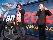 10 DECEMBER 2019 - DES MOINES, IOWA: An American Sign Language interpreter signs while ANDREW YANG, left, speaks in front of his bus parked at the Iowa State Capitol before the start of his bus tour. Yang, an entrepreneur, is running for the Democratic nomination for the US Presidency in 2020. He kicked off a five day bus tour today at the Iowa State Capitol in Des Moines. Iowa hosts the the first election event of the presidential election cycle. The Iowa Caucuses will be on Feb. 3, 2020.         PHOTO BY JACK KURTZ