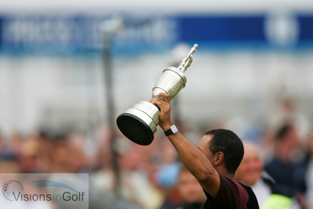 Tiger Woods holds the trophy aloft<br />The Open Championship 2005, St. Andrews Old GC, Scotland. <br />Picture credit: Mark Newcombe / visionsingolf.com