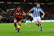 Steve Cook (3) of AFC Bournemouth clears the ball away from Laurent Depoitre (20) of Huddersfield Town during the Premier League match between Bournemouth and Huddersfield Town at the Vitality Stadium, Bournemouth, England on 4 December 2018.