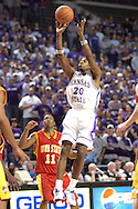 Kansas State forward Cartier Martin (C) scores past Iowa State's Will Blalock (lower left) in the second half at Bramlage Coliseum in Manhattan, Kansas, February 8, 2006.  K-State defeated the Cyclones 66-63.