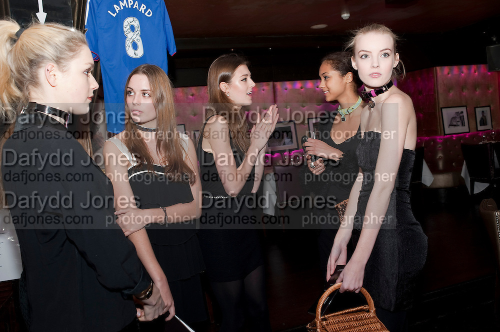 POPPY CHOLERTON; ABI FOX; ELLIE GRAHAM; TENISHIA MCSWEENEY; JESSICA PAIN, Bitch- Auction and fundraiser for the dog charity Care. The Cuckoo Club, London. 7 December 2010. -DO NOT ARCHIVE-© Copyright Photograph by Dafydd Jones. 248 Clapham Rd. London SW9 0PZ. Tel 0207 820 0771. www.dafjones.com.