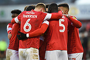 The Barnsley FC players embrace Conor Chaplin on his second goal during the EFL Sky Bet Championship match between Barnsley and Queens Park Rangers at Oakwell, Barnsley, England on 14 December 2019.