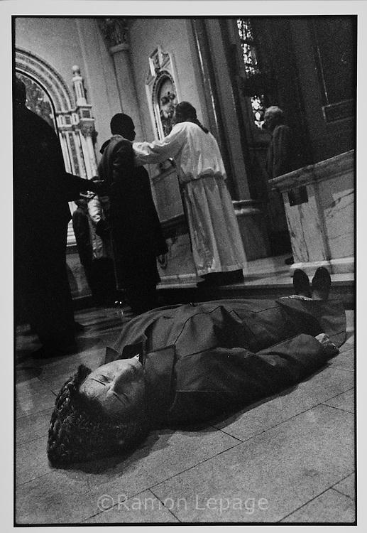 People Fall Down In Church during mass with Irish American preacher.  Boston.