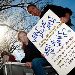 """Washington, DC, October 30, 2010 - Jon Stewert and Steven Colbert host the Rally To Restore Sanity and/or Fear.  Tens of thousands of ralliers donned costumes and carried signs.  John and Kat came from Pennsylvania.  """"A CIVIL AND RATIONALLY COMPELLING DISCUSSION OF THE FACTS"""""""