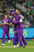 14th January 2019, Melbourne Cricket Ground, Melbourne, Australia; Australian Big Bash Cricket, Melbourne Stars versus Hobart Hurricanes; Matthew Wade and Johan Botha of the Hobart Hurricanes celebrate the opening wicket