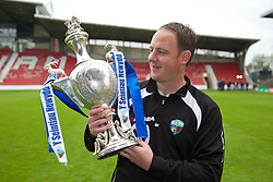 WREXHAM, WALES - Saturday, May 3, 2014: The New Saints' manager Carl Darlington celebrates with the trophy after beating Aberystwyth Town 3-2 to win the Welsh Cup Final at the Racecourse Ground. (Pic by David Rawcliffe/Propaganda)