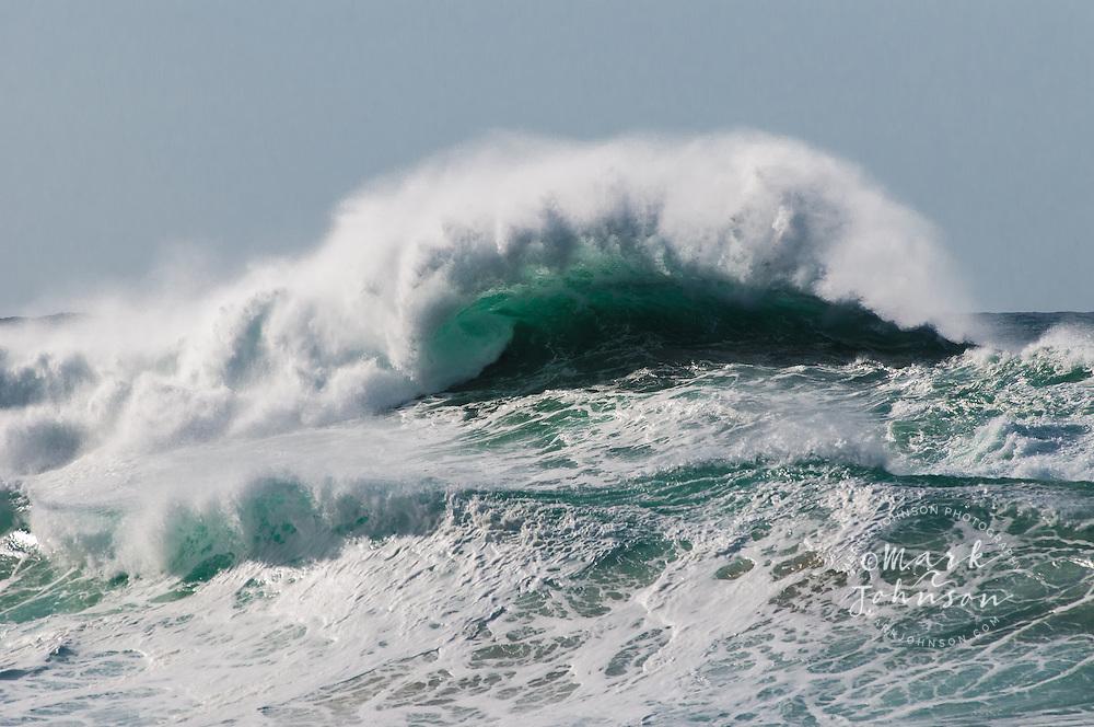 Dangerous but beautiful winter storm surf breaking off a lava rock shelf in Hawaii