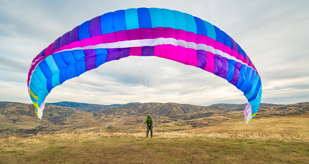 Paraglider Launching on a Hill near Horseshoe Bend, Idaho