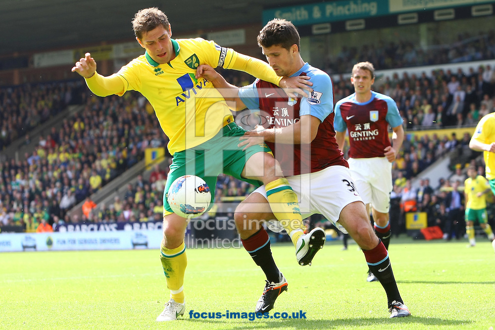 Picture by Paul Chesterton/Focus Images Ltd.  07904 640267.13/05/12.Grant Holt of Norwich and Eric Lichaj of Aston Villa in action during the Barclays Premier League match at Carrow Road Stadium, Norwich.