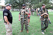 Confederate supporters gather at the Confederate Cemetery adjacent to Dallas City Hall proior to the beginning of the Anti Racism Rally in downtown Dallas on Saturday August 19, 2017. Anti white supremacy counter protestors vastly outnumbered them.