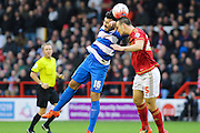 Nottingham Forest defender Jack Hobbs and Queens Park Rangers midfielder Michael Doughty challenge for the ball in the air during The FA Cup third round match between Nottingham Forest and Queens Park Rangers at the City Ground, Nottingham, England on 9 January 2016. Photo by Aaron Lupton.