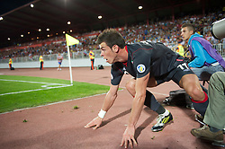 NOVI SAD, SERBIA - Tuesday, September 11, 2012: Wales' Gareth Bale crashes into a photographer during the 2014 FIFA World Cup Brazil Qualifying Group A match against Serbia at the Karadorde Stadium. (Pic by David Rawcliffe/Propaganda)