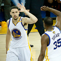 04 June 2017: Golden State Warriors guard Klay Thompson (11) celebrates with Golden State Warriors forward Kevin Durant (35) during the Golden State Warriors 132-113 victory over the Cleveland Cavaliers, in game 2 of the 2017 NBA Finals, at the Oracle Arena, Oakland, California, USA.