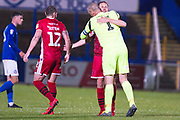 Morecambe goalkeeper Barry Roche celebrating the 1-0 win with team-mates during  the  EFL Sky Bet League 2 match between Macclesfield Town and Morecambe at Moss Rose, Macclesfield, United Kingdom on 20 August 2019.