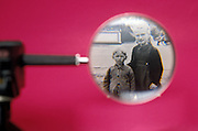 vintage photograph of children shown through magnifying glass