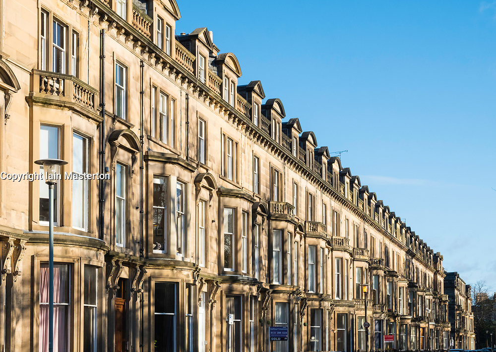 View of row of sandstone terraced apartments (tenements) on Learmonth Terrace in Edinburgh, Scotland, United Kingdom