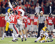 Mississippi kicker Andrew Ritter (96) celebrates his game winning field goal with holder Mississippi holder Chris Conley (94) as LSU's Jalen Mills (28) watches the ball go through the uprights at Vaught-Hemingway Stadium in Oxford, Miss. on Saturday, October 19, 2013. Mississippi won 27-24. (AP Photo/Oxford Eagle, Bruce Newman)