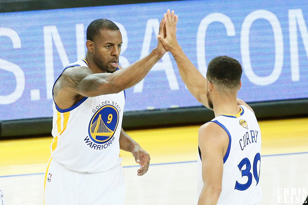 04 June 2017: Golden State Warriors forward Andre Iguodala (9) celebrates with Golden State Warriors guard Stephen Curry (30) during the Golden State Warriors 132-113 victory over the Cleveland Cavaliers, in game 2 of the 2017 NBA Finals, at the Oracle Arena, Oakland, California, USA.