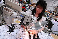 4/3/09 10:52:09 AM -- Easton, PA, U.S.A. -- Barbara Graver, a seamstress at Majestic Athletic sews lettering on the back of a Chicago White Sox jersey April 3, 2009 in Easton, Pennsylvania. White Sox jerseys and gear have experienced a boost in sales with Obama, a White Sox fan, in the White House. -- .Photo by William Thomas Cain,  cainimages.com