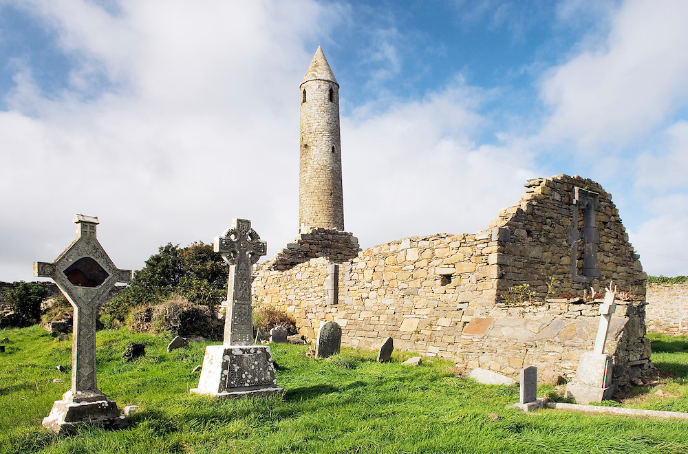The early Celtic Christian Round Tower and church at Rattoo, south of Ballybunnion, County Kerry, Ireland. Rises to 92 feet.