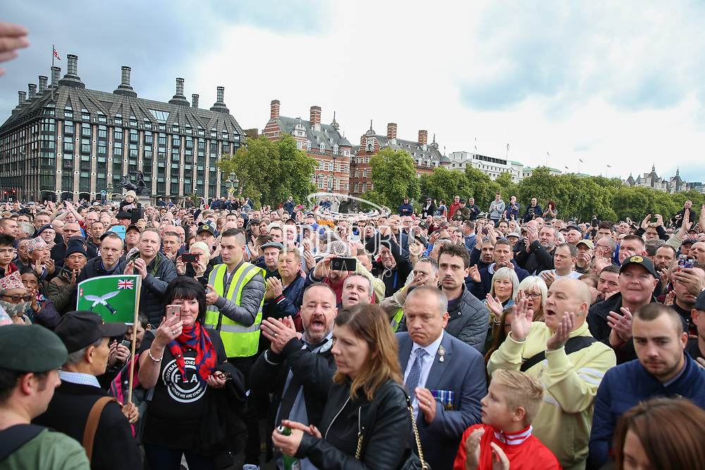 Supporters on Westminster Bridge listen to speeches during the Football Lads Alliance march between Park Lane and Westminster Bridge, London on 7 October 2017. Photo by Phil Duncan.