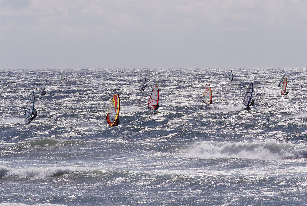 Windsurfers on the water near the nuclear power plant. Haroka, Japan.