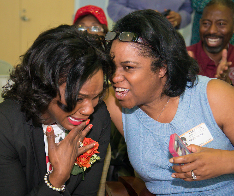Lockhart Elementary School principal Felicia Adams, left, is congratulated by Houston ISD trustee Paula Harris, right, after being named a finalist in the HEB Excellence in Education Awards, April 4, 2014.
