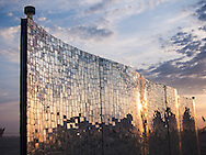 A mirrored mosaic wall art installation reflects the colors of the rising sun, Black Rock City, Burning Man.