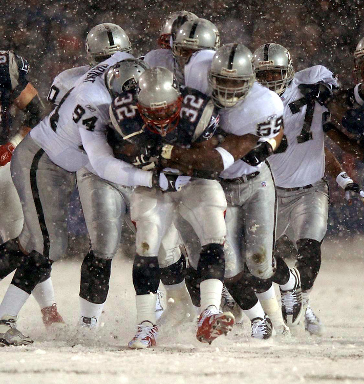 Raiders gang tackle 32 Antowain Smith of the Patriots.Picture taken during the AFC Championship between the Oakland Raiders and New England Patriots at Foxboro Stadium, Massachusetts, Saturday, January 19, 2002.