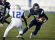 Duchesne running back Kaden Moon (2)  runs up the middle during the first half of the Utah High School 1A Football championship game between Duchesne and Rich in Pleasant Grove, Saturday, Nov. 10, 2012.