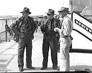 Gordon MacQuarrie, center, with Owen Gromme (r) and Lester Deitrich, both of the Milwaukee Public Museum, prior to their departure from Wisconsin to Alaska in September 1947.